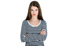 Young serious angry woman portrait. On a white background Royalty Free Stock Photos