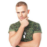 Young serious army soldier with military ID tags Stock Photo