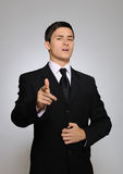Young serious business man in black suit and tie Royalty Free Stock Image