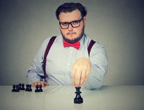 Serious business man playing chess game. Young serious business man playing a chess game Royalty Free Stock Photography