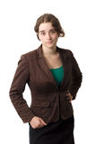 Young serious business woman on white background. Serious businesswoman on white background studio portrait with brown jacket and green shirt Royalty Free Stock Photo