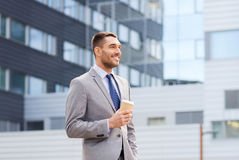 Young serious businessman with paper cup outdoors Royalty Free Stock Photo