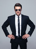 Young serious businessman in sunglasses Stock Photo