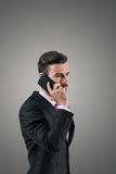 Young serious businessman talking on the cellphone Royalty Free Stock Photography