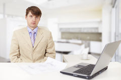Young serious businessman on a workplace Stock Photos