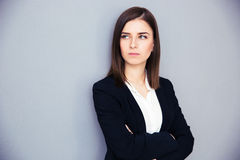 Young serious businesswoman with arms folded stock photos