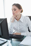 Young serious businesswoman sitting at her desk Royalty Free Stock Photo