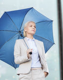 Young serious businesswoman with umbrella outdoors Royalty Free Stock Photos