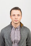 Young serious Caucasian man in casual clothing Royalty Free Stock Photography