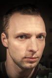 Young serious Caucasian man closeup portrait Stock Image