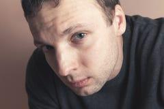 Young serious Caucasian man, closeup studio portrait Royalty Free Stock Photos