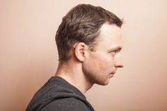 Young serious Caucasian man profile studio portrait Royalty Free Stock Photos