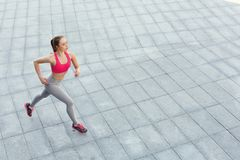 Young woman jogging in city copy space stock photography