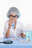 Young serious chemist with a pipette Stock Image