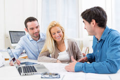Young serious couple meeting a real estate agent Royalty Free Stock Photo