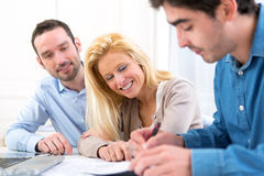 Young serious couple meeting a real estate agent Royalty Free Stock Images