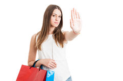 Young serious customer with shopping bags making a stop sign Stock Images