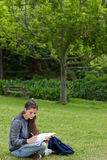 Young serious girl doing her homework Royalty Free Stock Images