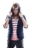 Young serious hooded man teen boy on white background. In studio Stock Image
