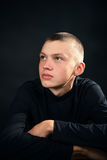 Young serious man in the black clothes Royalty Free Stock Image