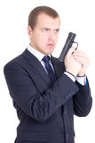 Young serious man in business suit with gun isolated on white Stock Images