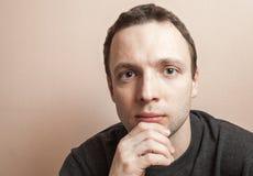 Young serious man, closeup studio portrait Stock Photos