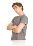 Young serious man with crossed arms Stock Images