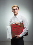 Young serious man in glasses with a drawing folder in hands Stock Images