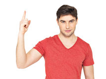 Young serious man with good idea sign Stock Photography