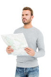 Young serious man holding a map Royalty Free Stock Photo