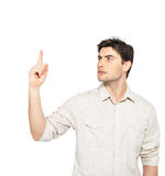 Young serious man points with finger up Stock Photos