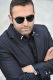 Young serious man portrait wearing sunglasses Royalty Free Stock Image