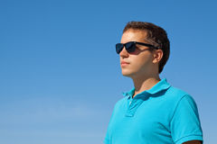 Young serious man in sunglasses Stock Photography
