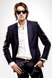Young serious man in sunglasses and suit Stock Photos