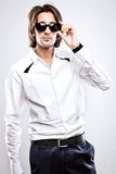 Young serious man in white shirt Stock Photo