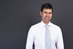 Young serious man in white shirt Stock Photography