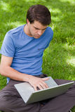 Young serious man working on his laptop Stock Photography