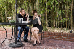 Young serious romantic couple dining on patio Stock Photography