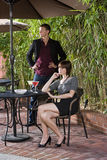 Young serious romantic couple dining on patio Royalty Free Stock Photos