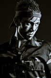 Young serious soldier in military uniform Royalty Free Stock Photography