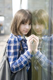 Young serious teen girl outdoor  near glass wall Royalty Free Stock Images