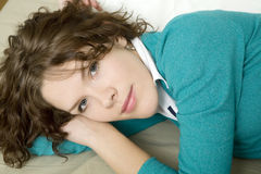 Young serious  woman in bed Stock Photo