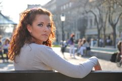 Young serious woman on bench Stock Images