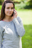 Young serious woman calling on her cellphone Stock Images