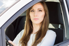 Young serious woman in car Royalty Free Stock Images
