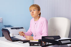 Young serious woman - chief in office Royalty Free Stock Photography