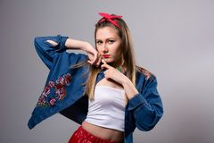 Young serious woman in colorful dress Royalty Free Stock Images