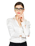 Young serious woman in glasses and white shirt Royalty Free Stock Photo