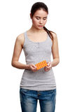 Young serious woman holding meds in the hands Stock Photo