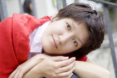 young serious woman in red scarf Stock Photos